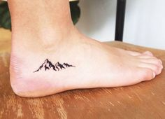 Image result for foot mountain tattoo