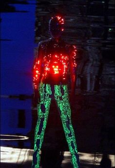 Tron-inspired suit with programmed multicolour flashing LEDs on transparent moulded body-suit by Kees van der Graaf for Alexander McQueen at Givenchy , Paris Autumn/Winter Ready to Wear Smart Textiles, E Textiles, Fashion Art, High Fashion, Fashion Show, Fashion Design, Timeless Fashion, Alexander Mcqueen, Mode Bizarre