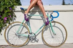 turquoise bike, purple shoes
