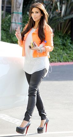 Kim Kardashian wore this amazing biker jacket, the Christopher Kane Crepe Biker Jacket in Neon Orange, as she left a production office in Los Angeles, California April 10, 2012