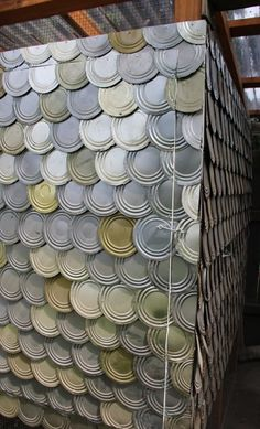Tin can lids used as shingles and siding on a chicken coop. This could be done on a shed, too!