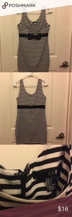 "Black and white strip mini dress from XXI - size L Dress is in gently used condition. Zipper and hook are still in same working condition as when purchased. Fit is very ""body on"" like to display your curves nicely. Forever 21 Dresses Mini"