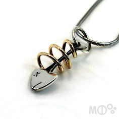 Small Fish Pendant 10 k yellow gold and Sterling by MCDecarie, $99.00
