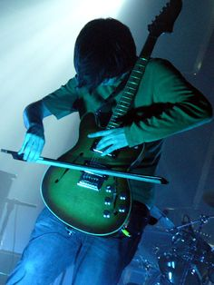 Jonny Greenwood, playing a guitar like only a trained cellist would...