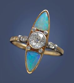 EARLY ART DECO ---- Strikingly Original Ring with Secession Influence ---- Gold Opal Diamond ---- French, c.1920
