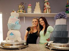 Sisters Jessica (left) and Jenny Pacaccio are flanked by custom cakes in The Sweet Life bakery.