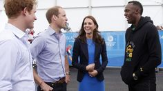 Prince Harry, the Duke and Duchess of Cambridge meet Usain Bolt during a visit to the Athletes' Village during day six