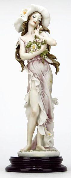 "GIUSEPPE ARMANI FIGURINE TITLED ""DAISY"" #202E.Depicting a Woman Holding a Bouquet of Daisy's."