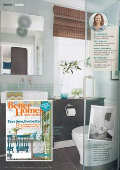 Cherry woven wood shades break up the hard lines in this bathroom and add all the warmth it needs. - As seen in Better Homes and Gardens May 2014