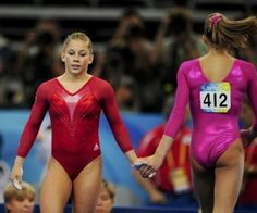 a picture truly worth a thousand words...Gymnastics #ShawnJohnson #NastiaLiukin