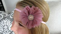 This beautiful handcrafted baby headband features a chiffon flower in dusty rose with exquisite pearl and rhinestone embellishment. The