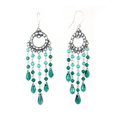 Emerald Swarovski crystals, silver, orient-inspired. Long, dangling and shiny earrings.
