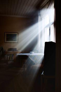 Sun's rays shining on kitchen table.