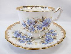 ...to teacups I have known...Vintage Aynsley Blue Cornflower Tea Cup & Saucer from Prairie Wind Antiques on Ruby Lane