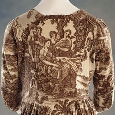 Berrington. View of the back of a copper-plate-printed informal cotton gown, c.1795-1800, decorated with designs from Fenelon's `The adventures of Telemachus, the son of Ulysses'.