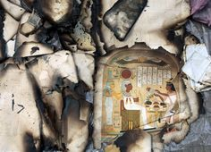 Ancient burnt and damaged books saved from a research center set up during the three-year occupation of Egypt by France in the late 18th century are seen at a restoration book center in Cairo. (AP)