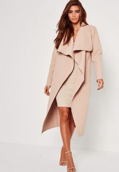Go for this nude oversized duster coat in a waterfall style to keep away the cold this season!