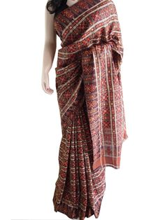 This is a very unique saree in pure silk with woven geometrical patterns all over. Saree has been worn a few times and is in excellent condition. It has no noticeable stains or tears. All used sarees are professionally cleaned before shipping.