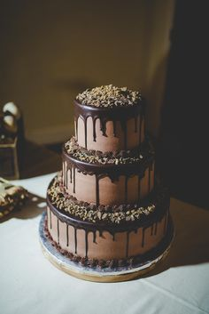 Dripping Hot Chocolate Over Your Cake | 10 Ways to Include Hot Chocolate in Your Wedding | https://www.theknot.com/content/hot-chocolate-wedding-ideas