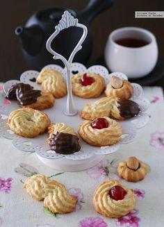 Pastas de té con almendra y naranja. Receta para tener siempre llena la caja de galletas
