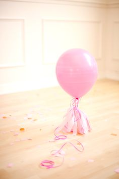 Love the idea of having helium balloons weighed down by simple tissue paper tassels. Such a sweet effect. #party #balloon
