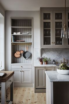 A serene farmhouse kitchen design with warm putty gray painted kitchen cabinets, beadboard, and marble backsplash in a gorgeous classic kitchen. Kitchen Corner, New Kitchen, Kitchen Decor, Kitchen Ideas, Shaker Kitchen, Kitchen Paint, Warm Grey Kitchen, Kitchen Layout, Kitchen Colors