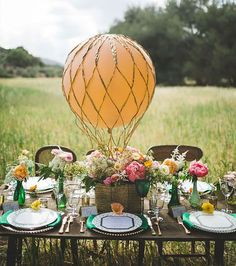 Instead of flowers and candles, get creative with a miniature hot air balloon as your centrepiece. Photo via Brit + Co.