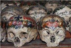 Painted skulls in the ossuary of Hallstatt, Saizkammergut, Upper Austria