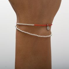 Pure sterling silver beads on coral silk cord. The beads are moveable on the silk thread. logo charm contains a tiny diamond. Silk Thread, Silver Beads, Cord, Pure Products, Sterling Silver, Diamond, Bracelets, Collection, Jewelry