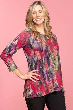 8960c0025eb688 Show off your style in this shape flattering abstract printed knit pullover  top. Designed with