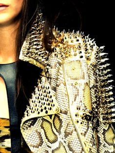 loveee. maybe without spikes would match my snakeskin boots! =]
