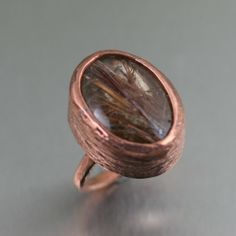 Slip on this 17 carat Copper Rutilated Quartz Cocktail Ring, flash it around, and see what happens. At the center of this sweet, bold handmade copper ring is a Copper Rings, Copper Jewelry, Handmade Rings, Handmade Jewelry, Handmade Copper, Copper Anniversary Gifts, Wedding Anniversary, Rutilated Quartz Ring, Cuff Earrings