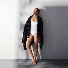 Black turkish light weight towel with stripes and raw edge fringing by Australian designer. Perfect for summer by the pool or as a beachtowel alternative. Kobn towels are perfect as a gift for people who love interior design or the outdoors. Also great for the fashion conscious.