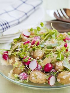 New potato salad with radishes, spinach and pea shoots