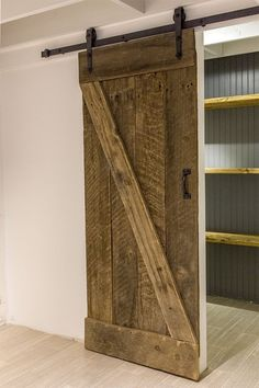 rustic, laundry room with sliding barn door