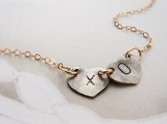 XO kiss hugs Initials necklace personalized initial oxidized silver heart, couple kids two initials necklace Heart Jewelry Valentines. $28.34, via Etsy.