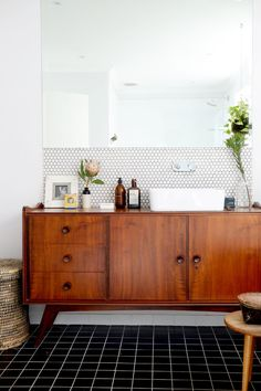 mid century vanity, penny tile, wall mount faucet, modern bathroom