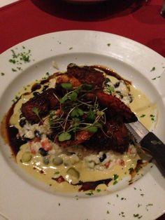 Surf and Turf (shrimp not lobster) on black bean risotto.  Chapel Grill Naples,Fl. Converted 65 yr old First Baptist Church.