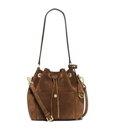 Exclusively Ours in the U.S. in Michael Kors stores and on michaelkors.com until 10/31/15. The perennially cool bucket bag has never looked more sumptuous. We've reinvented our iconic Greenwich in soft suede for a bohemian feel. Striking the perfect balance between laid-back and luxe, this piece will be one to covet for this season and beyond.