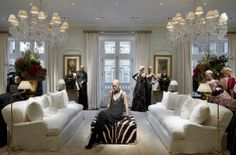 Love chandeliers and all white walls and curtains, Antiques pop and of course the ZEBRA is just superb-oh to have a skin on the floor or on an ottoman-what to do 888 Madison Avenue - NEW YORK