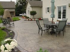 Stamped concrete patio.  A bit too dark for me, but I like the look of gray AND beige.  Get this look using an ashlar slate stamp pattern, sandstone color hardener, medium gray release, and a brick border stamp with smokey beige and a medium gray release.