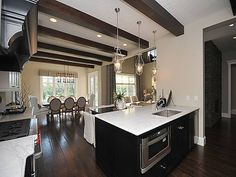 Kitchen/great room and nook in the Mackenzie built by Marcson Homes.