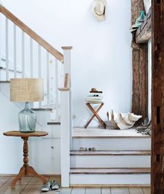 I love the painted and wood look of these stairs, might do this up to the second floor.