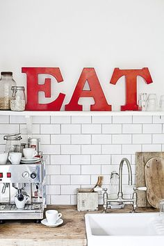 kitchen in red and white with EAT typography