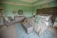 Gray and Aqua bedroom with Rustic barn door headboard