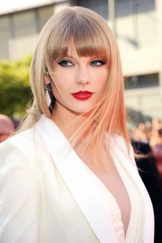 Taylor Swift has grown up with crimson lips and her new hair-cut.I love the color.It goes so well with the red lips.