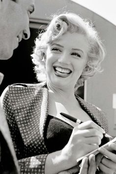 Marilyn Monroe signing an autograph to a fan on the set of Monkey Business, 1952: