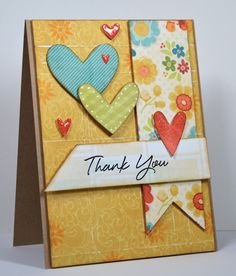I love this card because of its use of printed paper combinations to create a beautiful card.