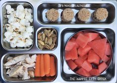 Fun food for kids. Packing healthy lunch boxes.  PB and J dots on whole wheat - Pop corn - Spiced pumpkin seeds - Roasted chicken breast - Carrots - Watermelon