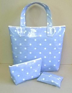 This is a lovely ladies tote bag Handmade in a pale blue oilcloth with white spots White zip closure to keep items safe inside Two matching strong handles to wear over the forearm Flat bottom and will stand up on its own Can be wiped clean or gently hand washed Measures approx - 12 1/2 inches x 10 inches (32 cm x 26 cm) Handles from zip to the top - 6 1/2 inches (17 cm) Will keep items dry inside or perfect to store damp clothes etc.. Perfect for carrying shopping, lunch or to take ...